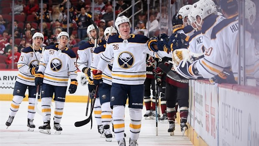 Rasmus Dahlin and teammates celebrate a goal vs. the Arizona Coyotes