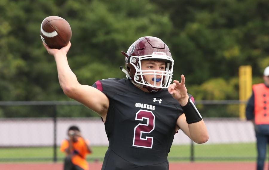 Senior quarterback Jack Sharp throws a pass