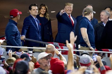 President Donald Trump and first lady Melania Trump, third from left, arrive for Game 5 of the World Series baseball game between the Houston Astros and the Washington Nationals at Nationals Park in Washington, Sunday, Oct. 27, 2019. Also pictured are Rep. Matt Gaetz, R-Fla., second from left, and Rep. Mark Meadows, R-N.C, right. (AP Photo/Andrew Harnik)
