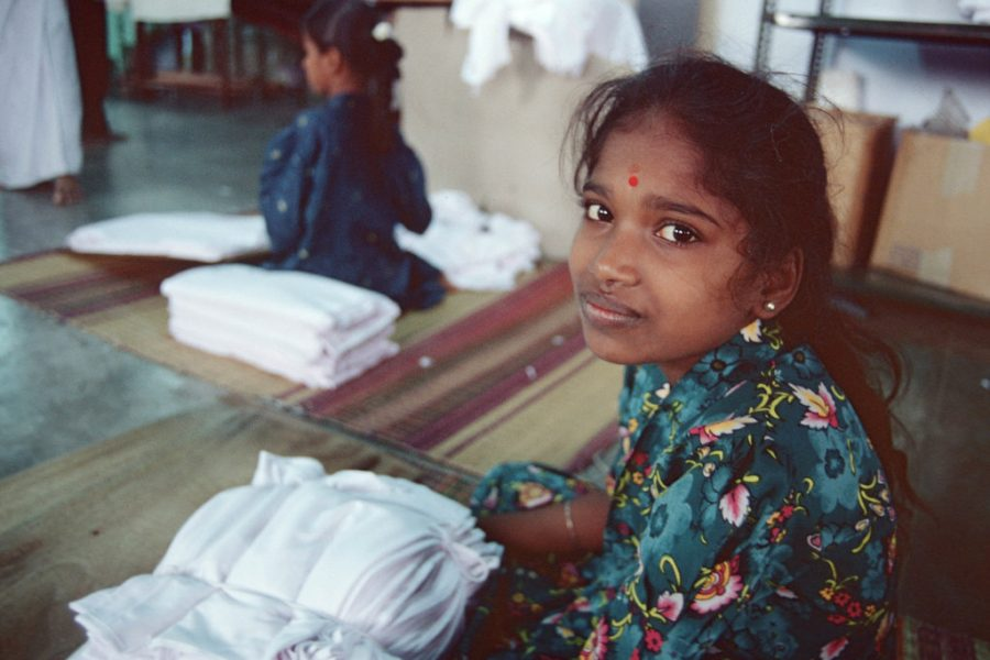 Indian youth working in textile mill